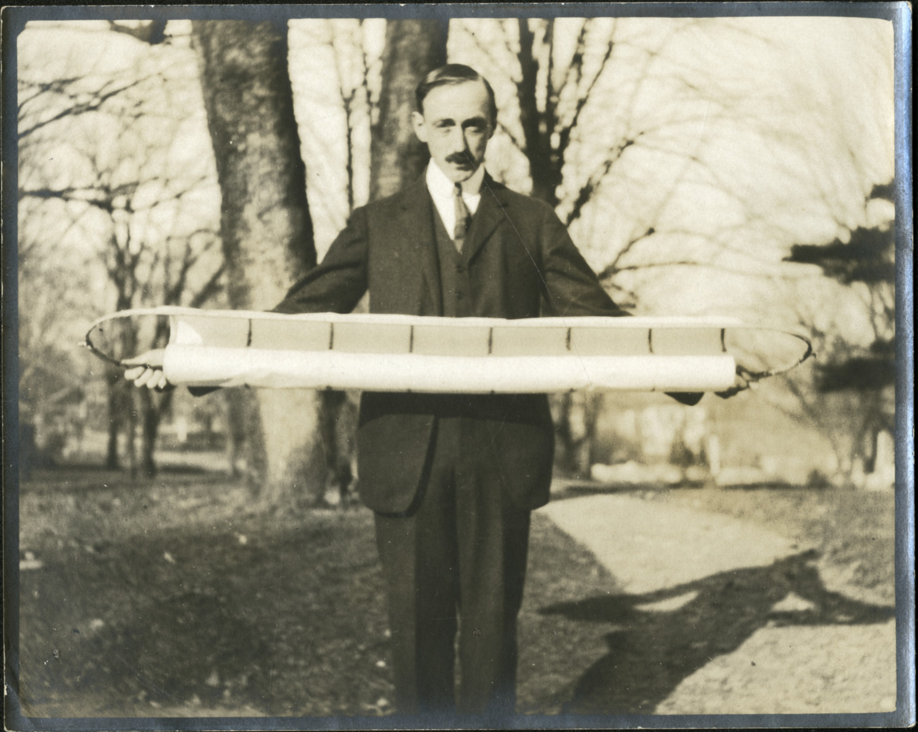 man holding a horizontal object